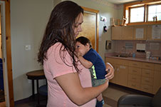 Photo of mom and baby in clinic room at Six Nations birth centre.