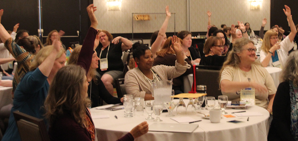 Midwives raising hands at AOM conference 2015