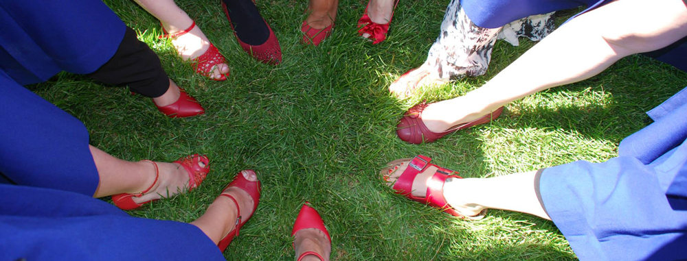 Midwifery students wearing red shoes at graduation